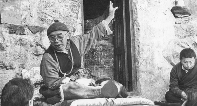 Kyabje Tulku Urgyen Rinpoche giving teachings in front of Asura Cave